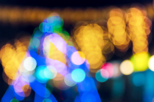new year tree abstract blur. city light on street in the distance. defocused image