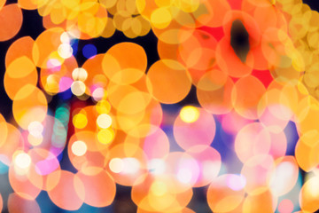 abstract christmass background. defocused city light. double exposure with new year tree