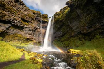 Rainbow at Kvernufoss waterfall , Iceland