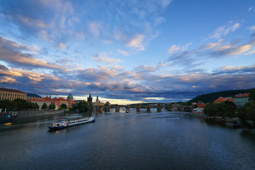 Famous Prague Charles bridge across Vltava river with ships famous European Czech republic landmark beautiful panorama view