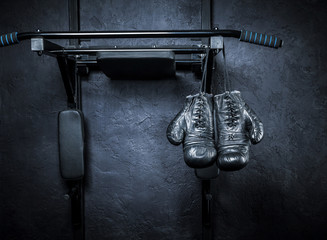 Wall Mural - Old boxing gloves on a dark background.
