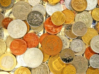 Close up top view image of large amount of old money coins of different countries and times on dollars usa background