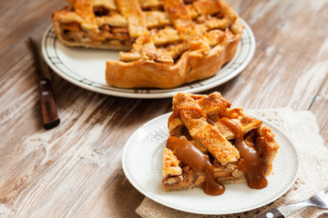 Slice of golden apple pie with caramel sauce