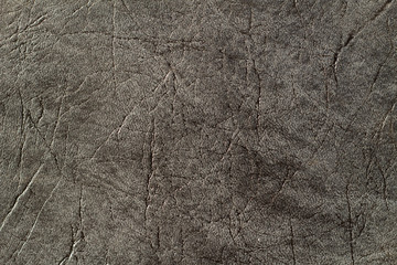Textured faux leather synthetic background closeup macro