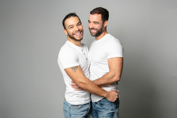 homosexual couple over a white background on studio