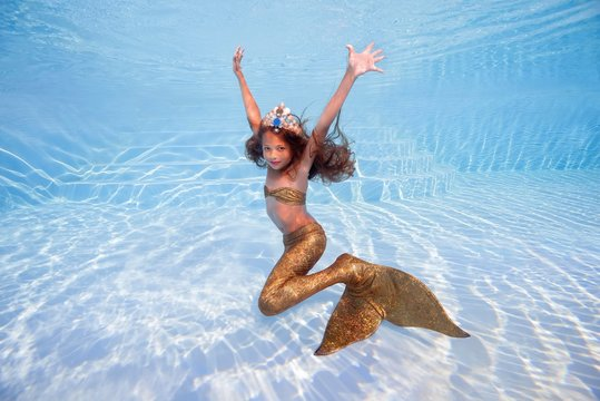 Girl in a mermaid costume poses underwater in a pool, Odessa, Ukraine, Europe