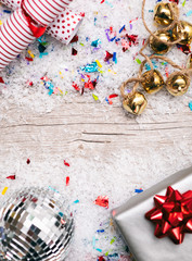 Holiday: Background With Noisemakers And Gift With Disco Ball