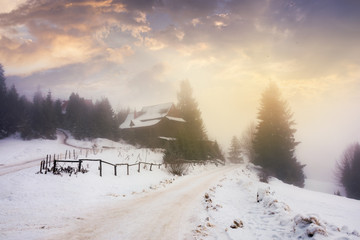 carpathian village at foggy winter sunrise. gorgeous rural scenery with gorgeous sky above