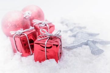 Christmas decoration balls and gifts on white background