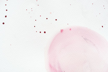 abstract light pink watercolor painting with splatters on white paper