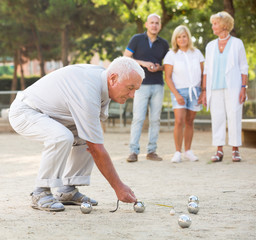Mature people playing bocce