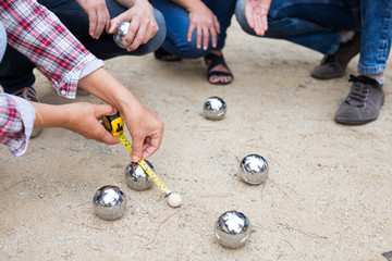 Hands of people playing petanque