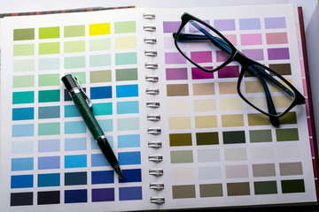 glasses and pen on the color palette