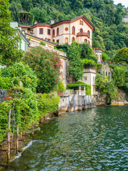 Scenic sight in Torno, colorful and picturesque village on Lake Como. Lombardy, Italy.