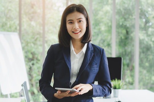 portrait of asian business woman in company meeting room.