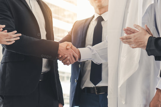 Two businessmen shaking hands together after contract agree complete.