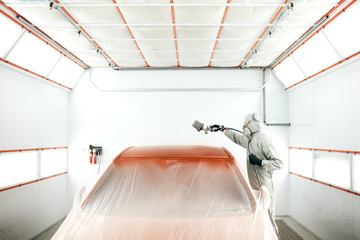 repairman painter in chamber painting automobile car roof