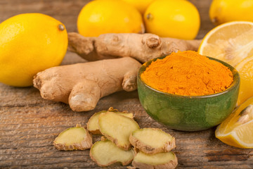 turmeric, lemon and ginger on a rustic surface, the concept of natural nutrition and medicine
