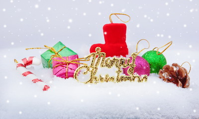 Christmas greeting card with snow and Christmas decorations