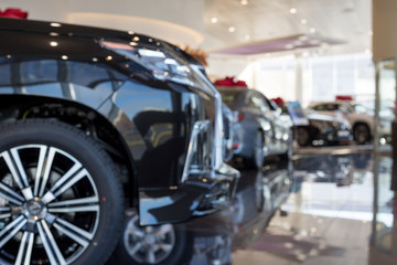 Car auto dealership.Themed blur background with bokeh effect. New cars at dealer showroom.