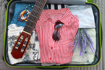 Close up of packing things for travel in a suitcase
