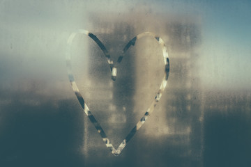Heart painted on misted glass. 4
