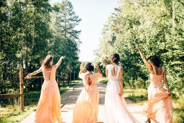 A happy bride enjoying with her bridesmaids