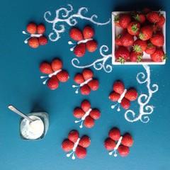 Overhead view of strawberries arranged in butterfly shape