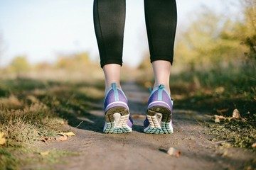 Low section of woman wearing sport shoe