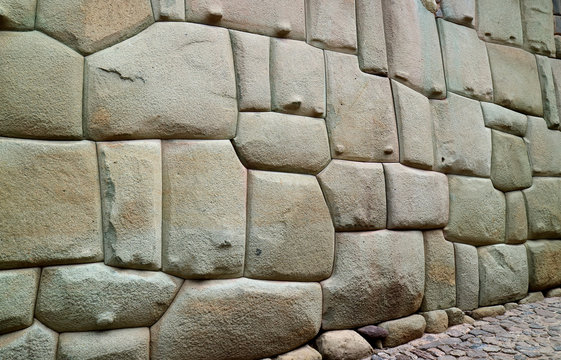 Incredible Inca Wall on Hatun Rumiyoc Street, the Ancient Street in Historic Centre of Cusco, Peru, South America