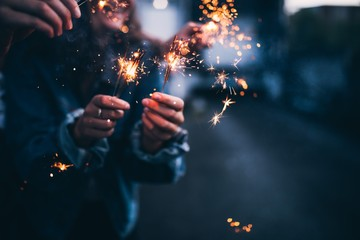 Mid section of woman holding sparkler