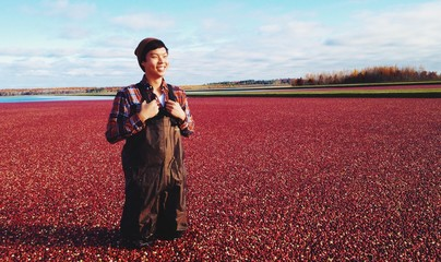 Smiling man standing in cranberry bog