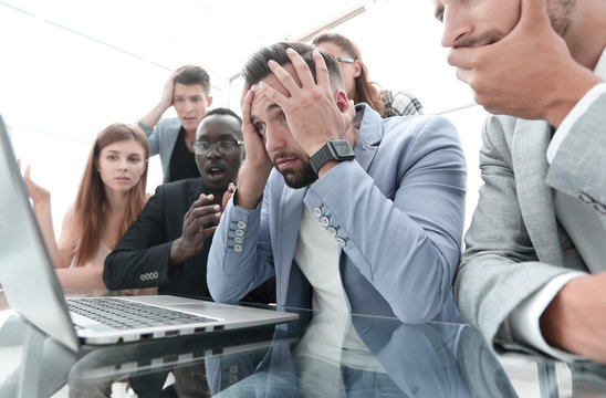 businessmens looking stressed in front of a laptop