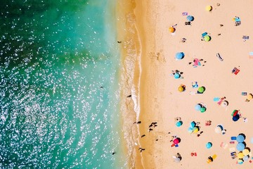 Aerial view of people relaxing on beach