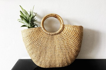 Pineapple in wicker bag