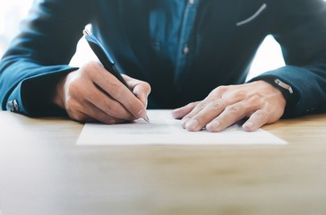 Businessman signing contract papers