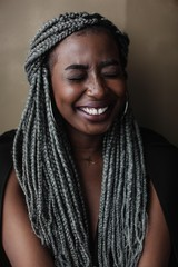 Close up of smiling woman with braided hair