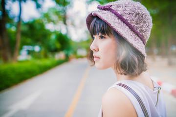 Teenage girl standing outdoors