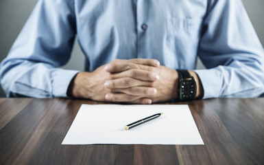Businessman thinking over the terms of the contract. Business concept