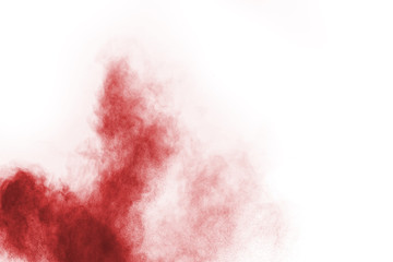 Red powder explosion on white background.