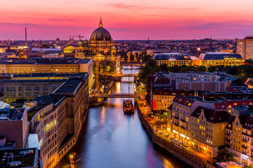 Aerial Berlin skyline panorama with TV tower and Spree river at sunset, Germany