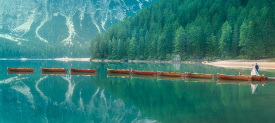 Bride and groom on lake di Braies, Italy