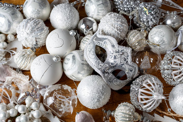 Silver Christmas toys for New Year and Christmas lie on a wooden background