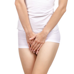 Gynecology concept. Young woman suffering from pain menstruation on white background isolation
