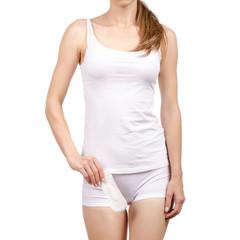 Woman female body hygienic napkin menstruation in hand on white background isolation