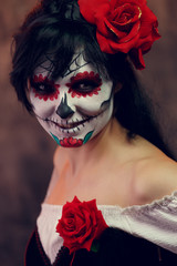 Photo of halloween girl with white makeup on her face