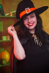 Photo of smiling witch in hat