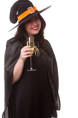 Picture of brunette witch in black hat with glass of champagne