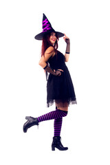 Picture of witch brunette in black dress and hat