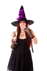 Picture of laughing witch in black hat, with glass of champagne